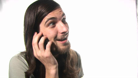 A young man holds a serious conversation on a cell phone Stock Video Footage