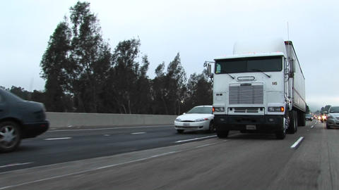 Cars and trucks drive on a crowded highway Stock Video Footage