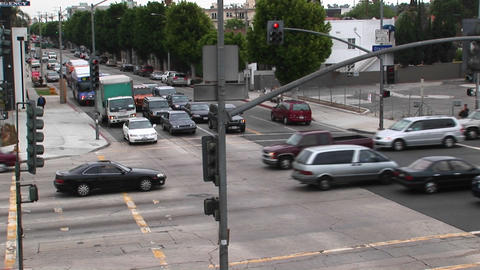 Traffic drives through a intersection Footage