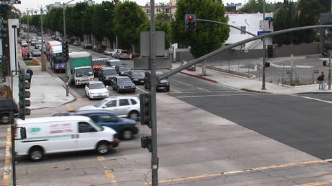Traffic drives through a intersection Stock Video Footage