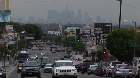 Congested traffic passes on a city street Stock Video Footage