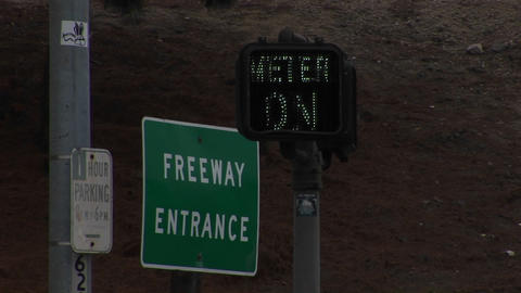 """A neon sign blinks next to a Freeway Entrance"""" sign Stock Video Footage"""