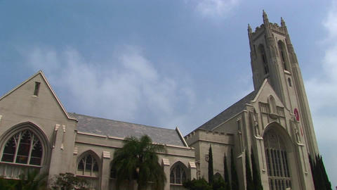 The sun shines on a large church Stock Video Footage