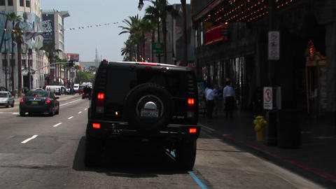 A limo drives through Hollywood Stock Video Footage