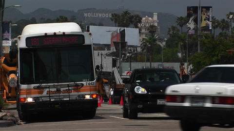 Cars drive around Hollywood Stock Video Footage