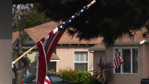 Flags hang from houses in a neighborhood Stock Video Footage