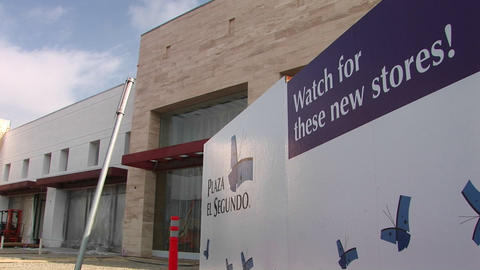 A board advertises for new stores Stock Video Footage