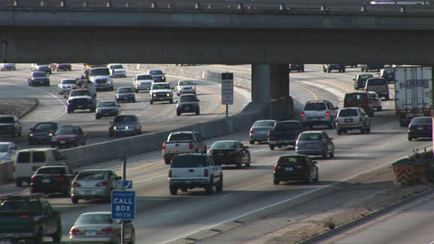 Heavy traffic drives on the interstate Stock Video Footage