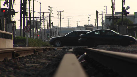 Cars drive over a railroad track Stock Video Footage