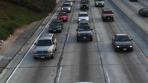 Traffic moves along a freeway Footage