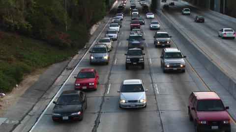 Traffic moves along a freeway Stock Video Footage