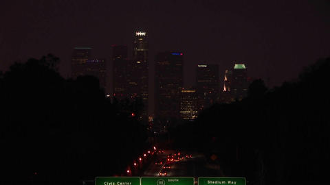 A time lapse of vehicles driving on the freeway and into... Stock Video Footage