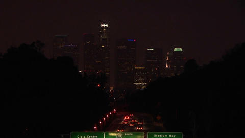 A time lapse of vehicles driving on the freeway and into the city at night Footage
