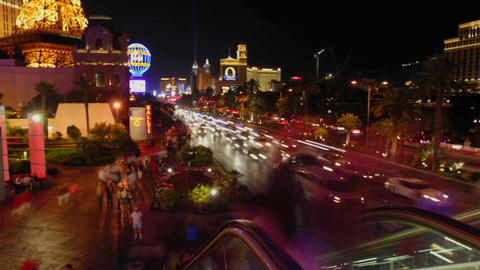 A time lapse of vehicles and people at night in Las Vegas Stock Video Footage