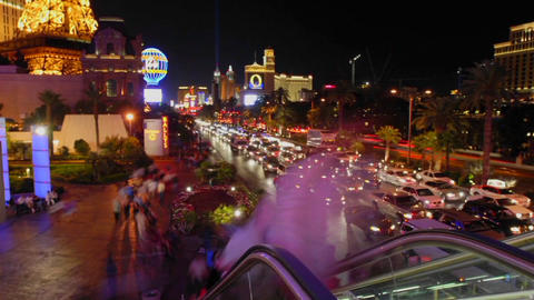 A time lapse of vehicles and people at night in Las Vegas Footage