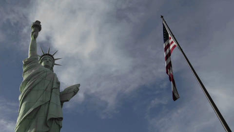 A time lapse of clouds moving over the Statue of Liberty... Stock Video Footage