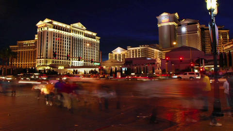 A time lapse of pedestrians and vehicles near hotel casinos in Las Vegas Footage