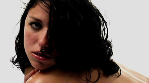 A topless woman with damp hair looks in the direction of... Stock Video Footage