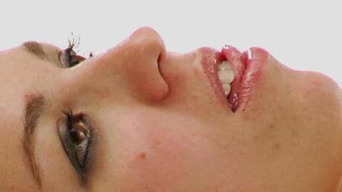 A Woman Slides Her Tongue Over Her Teeth stock footage