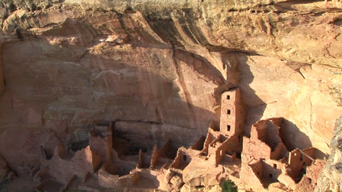 A cliff rises above Pueblo Indian dwellings in the Mesa... Stock Video Footage