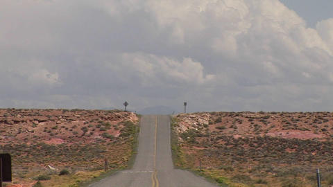 A deserted desert road and clouds in the sky Stock Video Footage