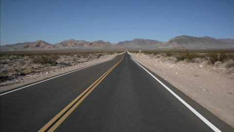 A highway runs through the desert Stock Video Footage