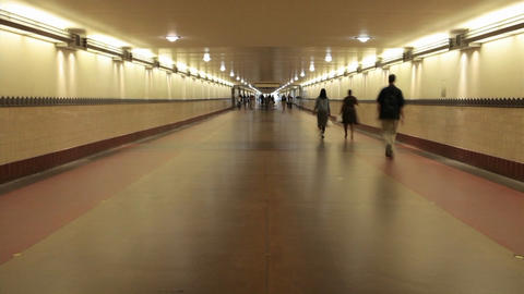 A time lapse of pedestrians walking through a long hallway Stock Video Footage