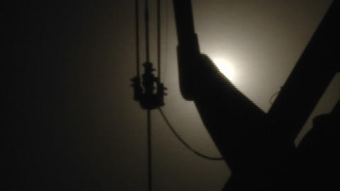 Silhouette of an oil pumpjack in operation Stock Video Footage