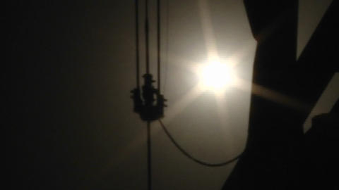 Silhouette of an oil pumpjack in operation Footage
