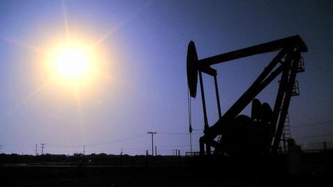 Silhouette of oil pumpjacks in operation Footage