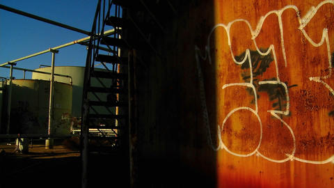 Time lapse of a graffiti covered wall passing into shadow... Stock Video Footage