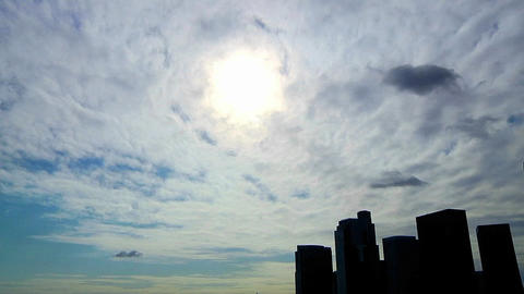 Time lapse of clouds passing over an urban skyline in... Stock Video Footage
