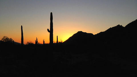 Time lapse of the sun setting on a desert scene Stock Video Footage
