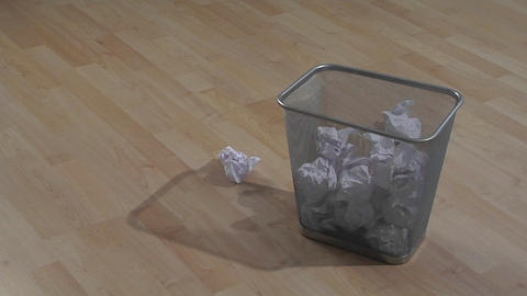 Pieces of waste paper are thrown into a garbage can. One... Stock Video Footage