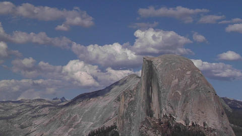 Time lapse of clouds moving over Half Dome in Yosemite National Park Footage