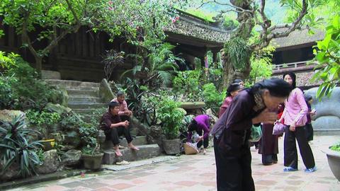 Vietnamese women practice tai chi near an old temple Stock Video Footage