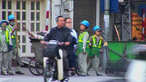 Garbage collectors clean up the streets in Vietnam Stock Video Footage