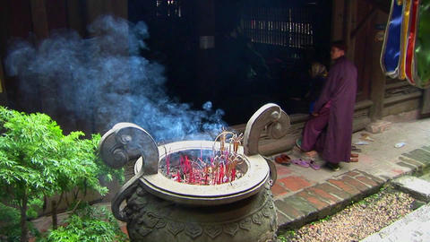 Monks gather as incense scents the air at a Vietnamese... Stock Video Footage