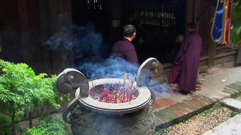 Monks gather as incense scents the air at a Vietnamese temple Footage