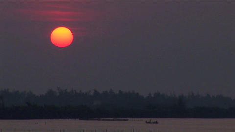 A sunset over the Mekong River in Vietnam Stock Video Footage