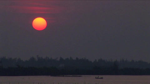 A sunset over the Mekong River in Vietnam Footage