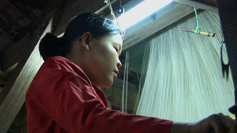 A woman operates a loom in a factory in Vietnam Footage