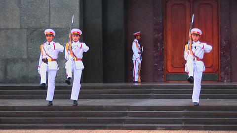 Soldiers march in formation outside the tomb of Ho Chi... Stock Video Footage