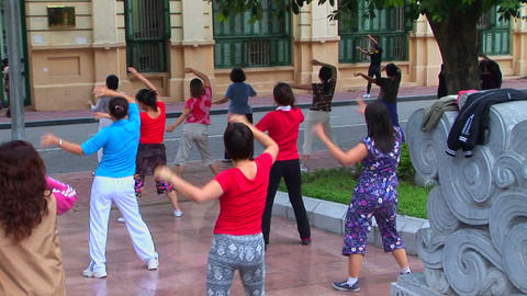 Vietnamese women do a modern workout in the morning Stock Video Footage