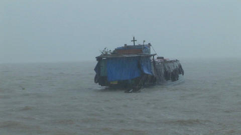 A dilapidated vessel heads out into a heavy storm Footage