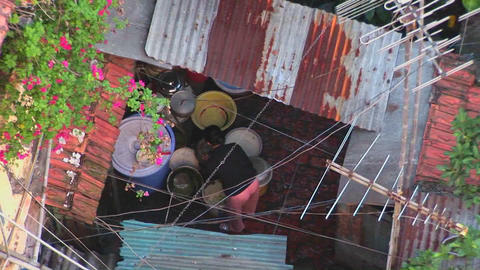 Pull back from a woman working on a rooftop to reveal a... Stock Video Footage