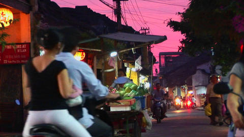 Vendors wheel their wares out at dusk in a Vietnamese... Stock Video Footage