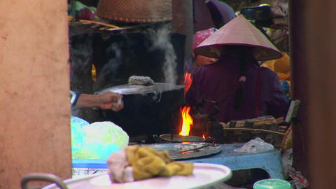 Fires Burn And A Pot Boils As Vietnamese Villagers Prepare A Meal stock footage