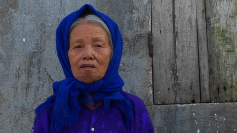 An old woman in Vietnam peers at the camera Stock Video Footage