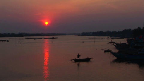 The sun sets behind the Mekong River in Vietnam Footage